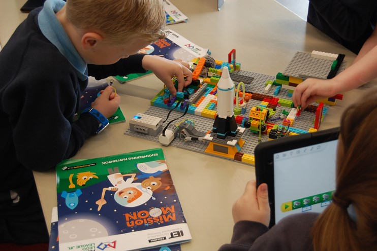 Child taking part in FLL Explore